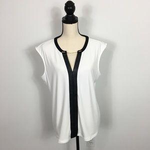 Woman's white Calvin Klein sleeveless blouse.